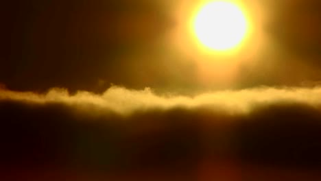 Time-lapse-of-the-sun-behind-golden-clouds