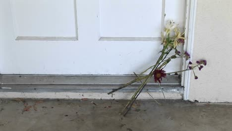 Flowers-are-left-on-a-doorstep