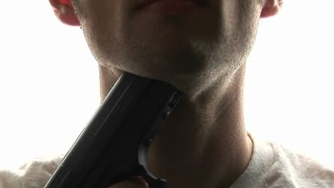 A-man-puts-a-pistol-against-his-throat-and-pulls-the-trigger-committing-suicide