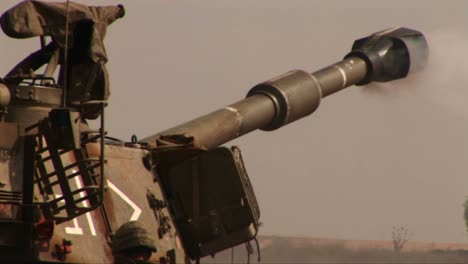 An-army-tank-fires-and-recoils-on-a-battlefield-in-the-Middle-East