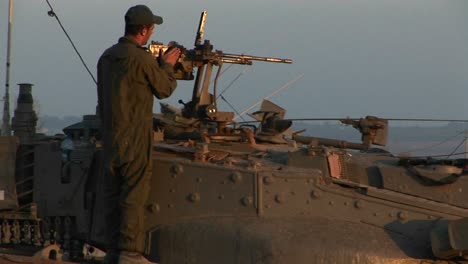 An-Israeli-soldier-stands-on-a-tank-during-a-standoff-at-the-Gaza-strip