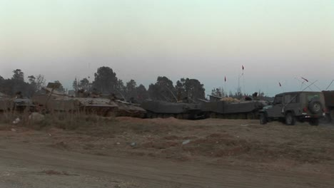 Armored-vehicles-wait-at-an-Israeli-army-staging-post-at-the-Gaza-strip-border