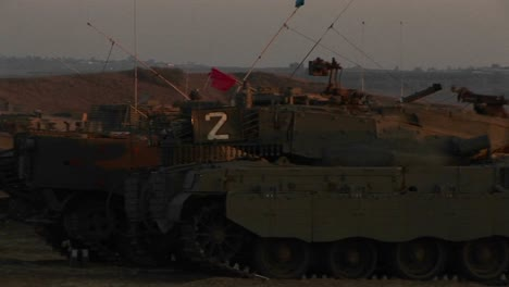 Israeli-armored-vehicles-wait-at-an-army-staging-post-on-the-Gaza-Strip-border