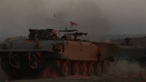 Israeli-armored-personnel-carriers-roll-into-battle-along-the-border-with-the-Gaza-Strip
