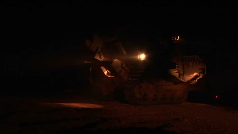 An-Israeli-armored-bulldozer-patrols-the-Israel-Gaza-Strip-border-at-night