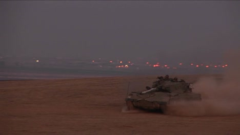 An-Israeli-tank-moves-across-a-no-man-s-land-between-Israel-and-the-Gaza-Strip