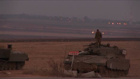 A-soldier-climbs-down-from-an-Israeli-tank