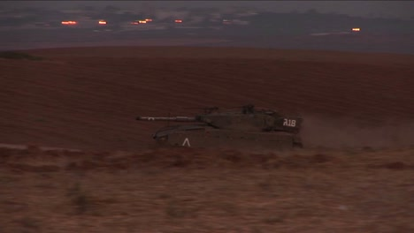 An-Israeli-tank-moves-through-a-no-man-s-land-on-the-border-of-Israel-and-the-Gaza-Strip-1