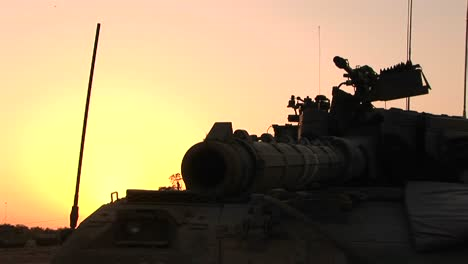An-Israeli-tank-is-silhouetted-against-a-multi-colored-sky