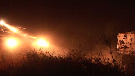 An-Israeli-army-tank-moves-on-patrol-through-a-border-region-with-high-powered-lights