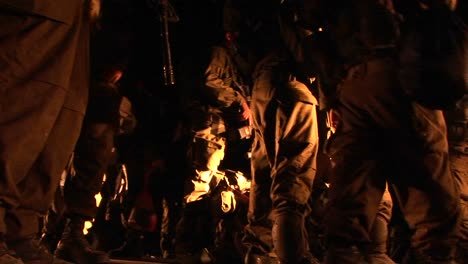 Israeli-soldiers-with-guns-mill-about-during-a-night-patrol