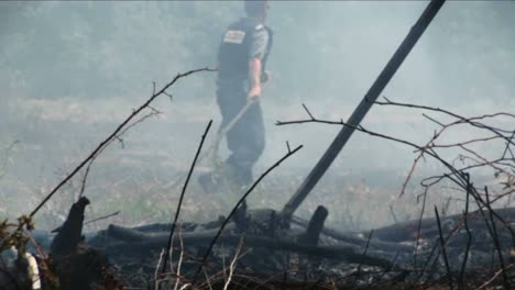 Israeli-police-and-fire-officials-work-to-put-out-a-fire-started-by-a-rocket-launched-during-the-Israel-Lebanon-war