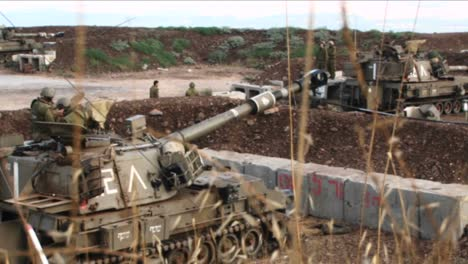 An-Israeli-army-tank-moves-its-barrel-into-firing-position-during-the-Israel-Lebanon-war