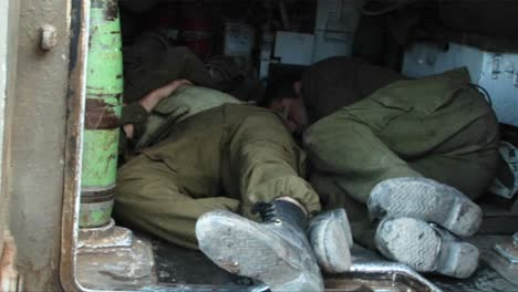 Israeli-army-officers-get-some-rest-in-the-back-of-a-tank-during-the-Israel-Lebanon-war