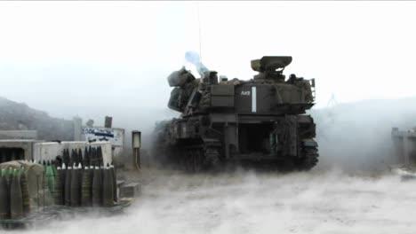 An-Israeli-army-tank-fires-shells-across-the-border-in-the-Israel-Lebanon-war
