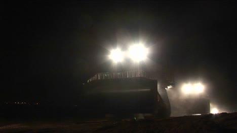 Armored-Israeli-bulldozers-move-along-the-Gaza-Strip-border-in-a-night-patrol-operation