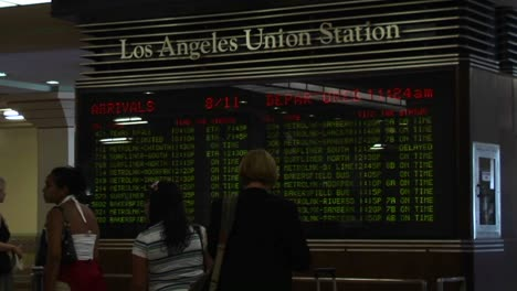 Passengers-look-at-train-arrivals-and-departures-at-the-Los-Angeles-Union-Station