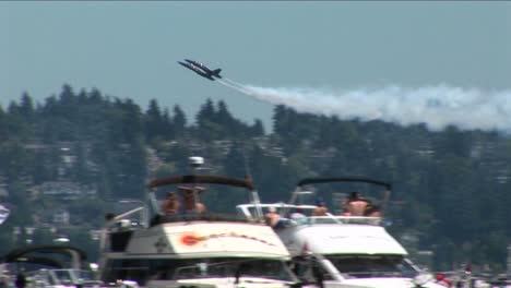 Blue-Angels-jets-fly-over-crowds-of-people-and-boats-