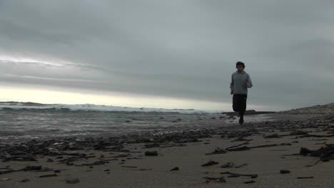 A-jogger-runs-on-a-beach