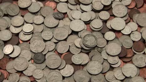A-pile-of-coins-sits-on-a-table