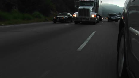 Cars-and-trucks-drive-by-on-a-crowded-highway
