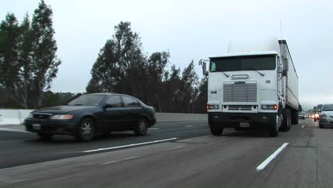 Cars-and-trucks-drive-on-a-crowded-highway
