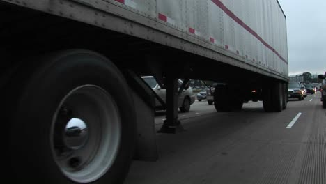 Cars-and-trucks-drive-on-a-crowded-highway-1