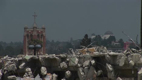 Pigeons-walk-on-a-pile-of-rubble