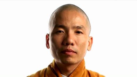A-Buddhist-monk-wearing-an-orange-robe-