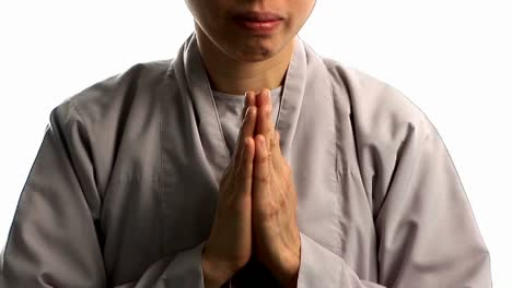 A-young-Buddhist-monk-prays-3