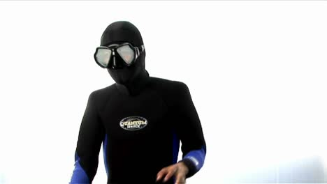 A-man-wearing-a-full-body-wetsuit-hood-and-goggles-practices-martial-arts