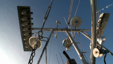Skyward-view-of-a-fish-cutters-mast-with-equipment