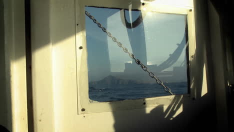 An-island-is-viewed-through-a-boat-window