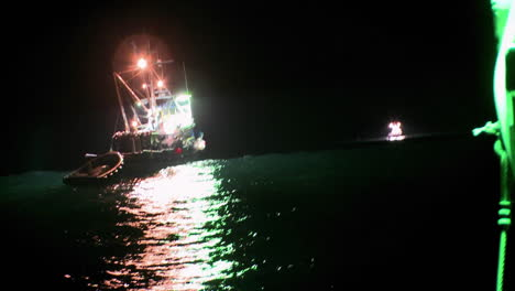 A-fish-cutter-works-at-night-with-lights-on