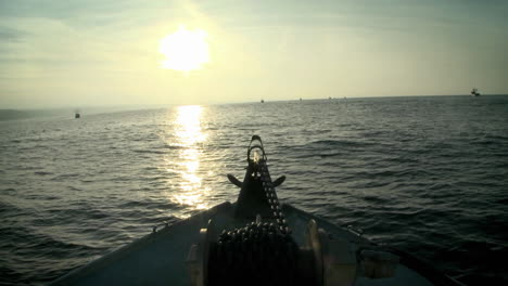 A-boat-moves-through-the-water-as-the-sun-sets