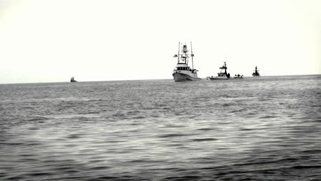 A-group-of-boats-sit-together-in-the-ocean