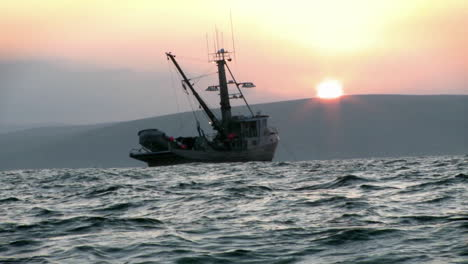 A-fishing-vessel-navigates-just-off-shore