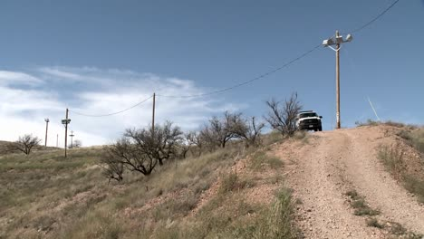 A-vehicle-sits-on-a-path-in-a-remote-area