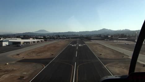 A-plane-heads-down-a-runway-and-takes-off