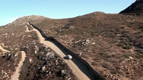 A-car-drives-along-a-remote-road