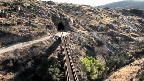 Smoke-rises-as-an-indication-that-a-train-is-coming-across-a-bridge-and-heading-for-a-tunnel