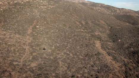 A-helicopter-flies-over-a-remote-hilly-region
