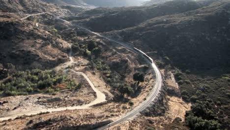 A-train-travels-through-a-rough-desert-terrain