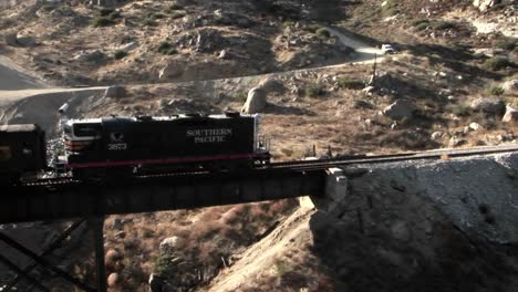 A-railroad-train-crosses-over-a-bridge