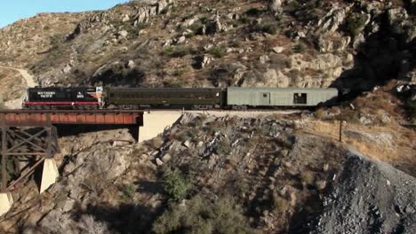 A-freight-train-is-traveling-through-a-mountain-tunnel