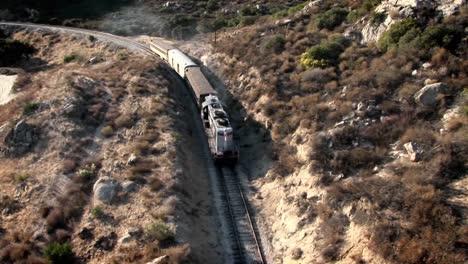 A-train-travels-through-a-mountainous-area