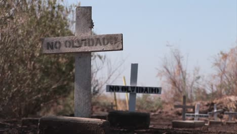 A-pathway-is-lined-with-plain-wooden-crosses-marked-only-with-the-words-no-olvidado-or-not-forgotten