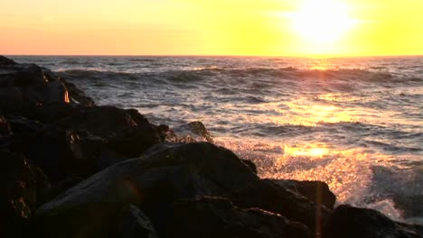 Ocean-waves-crash-into-rocks-at-sunset-2