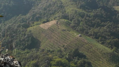 An-aerial-view-of-a-farm-from-high-above-on-a-hillside