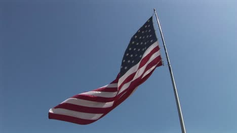 An-American-flag-flies-in-the-wind-at-day